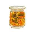 Jar of colourful pasta glass fusilli Royalty Free Stock Photography