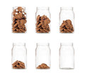 Jar of cookies sequence from full to empty isolated on white background Stock Photography