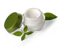 Jar of cream jars with green leaves isolated on white with clipping path Stock Photography