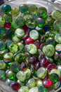 Jar of dusty colorful glass beads for plant decoration Royalty Free Stock Photo
