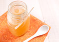 Jar with fresh honey on orange napkin horizontal Royalty Free Stock Photo