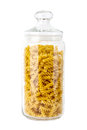 Jar of fusilli pasta on white glass containing a background with a clipping path Stock Photos