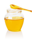 Jar with honey glass of golden a wooden spoon Stock Photo