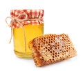 Jar of honey and honey honeycombs Royalty Free Stock Image