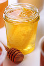 Jar of honey with honeycomb Royalty Free Stock Image