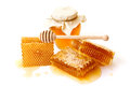 Jar of honey with honeycombs and on white background Royalty Free Stock Images