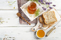 Jar of honey  and toast for breakfast. Royalty Free Stock Photo