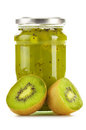 Jar of kiwi jam on white background preserved fruits Stock Images