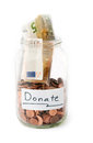 Jar with money from donation full of charity Stock Photos