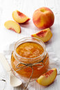 Jar of peach jam Royalty Free Stock Photo
