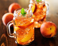 Jar of peach tea shot with selective focus Royalty Free Stock Images