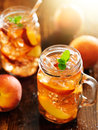 Jar of peach tea shot vertically Royalty Free Stock Photography
