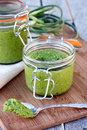Jar of pesto glass filled with Stock Images