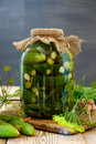Jar of pickles on wooden table Royalty Free Stock Photo
