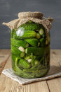 Jar of pickles on wooden table salted cucumbers still life Stock Images