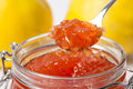 Jar with Quince Jam and Spoon Royalty Free Stock Photo