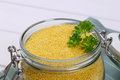 Jar of raw millet Royalty Free Stock Photo