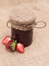Jar with strawberry jam homemade and fresh fruits on rustic background Stock Photography