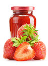Jar of strawberry jam on white background preserved fruits Royalty Free Stock Image