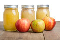 Jars of apple sauce with apples fresh red Stock Images