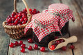 Jars of cranberries jam and basket with bog berry Royalty Free Stock Photo