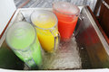 Jars of fresh juice on ice three green yellow and red water Royalty Free Stock Photo