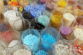 Jars full of colored beads Royalty Free Stock Photography