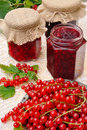 Jars of homemade red currant jam with fresh fruits Royalty Free Stock Photo