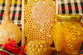 Jars of honey, honeycomb and products Stock Photos