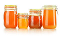 Jars of honey  on white Stock Photos