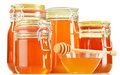 Jars of honey on white composition with background Stock Image