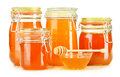 Jars of honey on white composition with background Royalty Free Stock Image