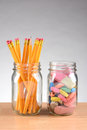 Jars with Pencils and Erasers Royalty Free Stock Photo