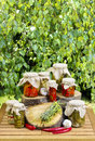 Jars of preserves on wooden table in the garden healthy food Stock Image