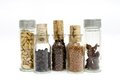 Jars of spices glass container filled with and cork stopper Royalty Free Stock Photos