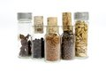 Jars of spices glass container filled with and cork stopper Stock Photography