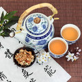 Jasmine flower tea with oriental style teapot cups and spoon and chinese calligraphy su xin hua Stock Images
