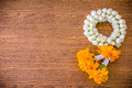 jasmine garland thai style on wood background Royalty Free Stock Photo