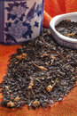Jasmine tea with blue and white chinese ceramic leaves on an orange tablecloth jar Royalty Free Stock Photography