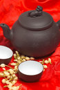 Jasmine tea over red silk Stock Image