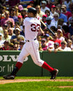 Jason varitek boston red sox catcher pulls a pitch down the rightfield line Stock Image