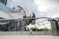 Jay pritzker pavilion chicago usa august young girl walking near the at the millenium park in chigago in a sunny day Stock Photo