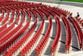 Jay pritzker pavilion in millennium park chicago few men seating and reading empty auditorium of famous Stock Photo