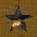 Jazz guitar in breach of a brick wall Royalty Free Stock Photo