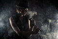 Jazz singer woman with retro microphone on black background Royalty Free Stock Images
