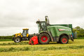A JCB fastrac tractor with Fendt Katana 65 forager Royalty Free Stock Photo