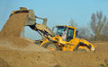 JCB working in gravel yard. Royalty Free Stock Photo