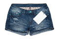 Jean short pants with price tag image of blue Royalty Free Stock Image