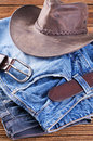 Jeans and Akubra on a Wooden Board Royalty Free Stock Photos