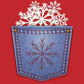 Jeans back pocket with snowflakes on a red background.